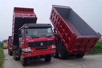 China major truck industries SINOTRUK HOWO left hand drive used dump trucks to Africa for sale