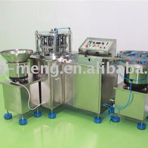 Automatic compound machine for rubber plug and plastic cap of hemostix