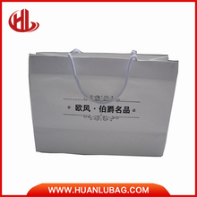 white special paper gift bags with black prints medium size