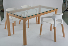 good quality glass long dining table with wooden legs