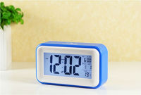 LCD digital alarm clock with adjustable backlight