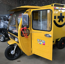 Electric three wheel vehicle for cargo transport with closed cab