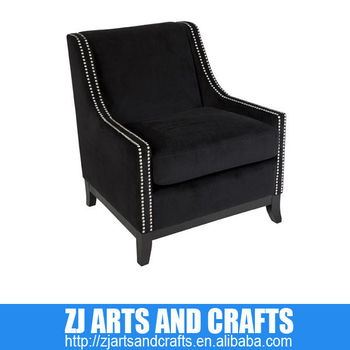 0478 living room sofa (Black Velvet covered occasional chair with matt silver stud trim and black finish wooden legs.)