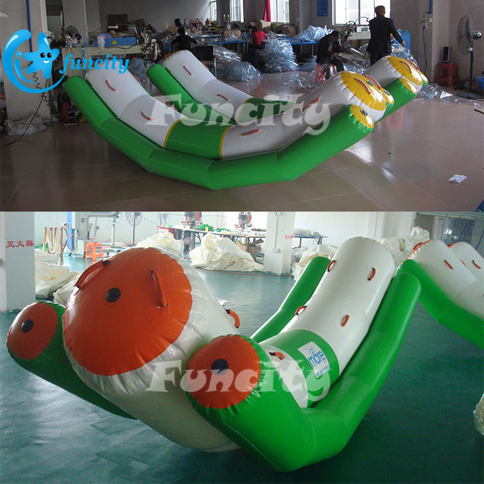 Durable PVC Tarpaulin Inflatable Water Totter Water Game In Hot-welding machine