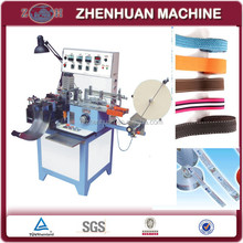 Automatic ribbon label cut and fold machine for fabric label
