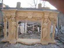 Pillar and nude woman carved fireplace