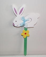 wooden rabbit with ribbon ornaments Stick for spring in garden