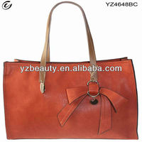 Genuine leather match PU with bowknot decorate bag has hand