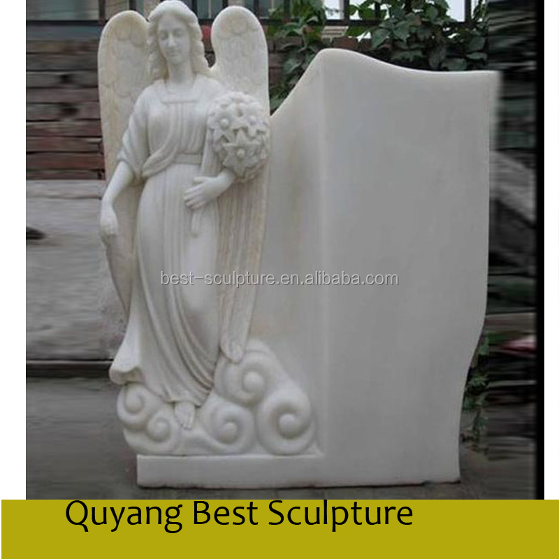 white marble grave stone tombstone with angel statue sculpture