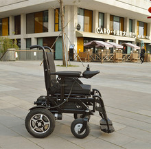 handicapped manual Electric folding wheelchair with reclining and folding backrest.