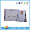 Low cost luxury paper shopping bag with logo UV