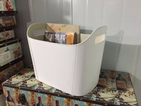 White faux leather magazine rack with the handle