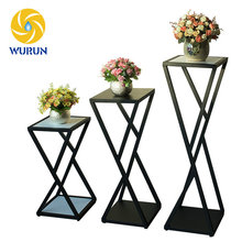 China Manufacturer Classic Iron X Shape Planting Display Rack Wire Flower Stand