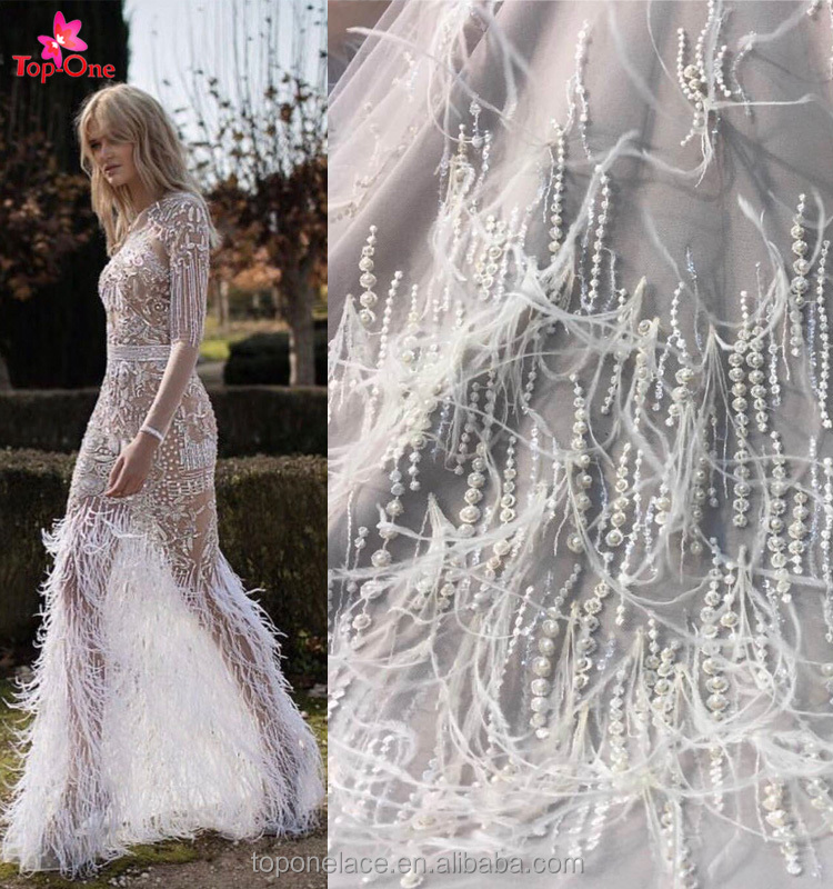 2017 Wholesale Haute Couture Handmade Beaded Dubai Fabric White 3d Lace Fabric Beads Bridal French Lace Fabric With Feather