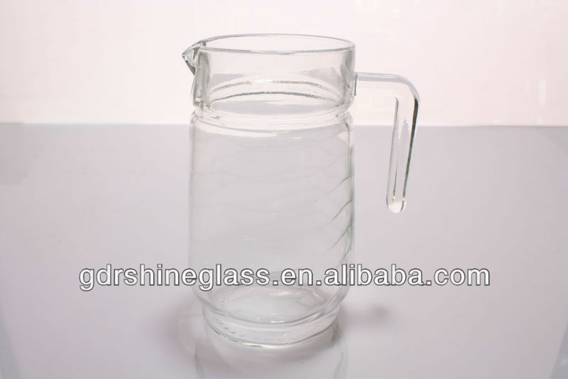 Hand clear glass water jug with lid