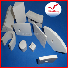 Wear resistant alumina tiles are supplied with a tapered hole,metal insert and an alumina cap
