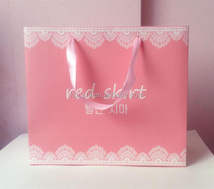 Paper shopping bags with ribbon handle