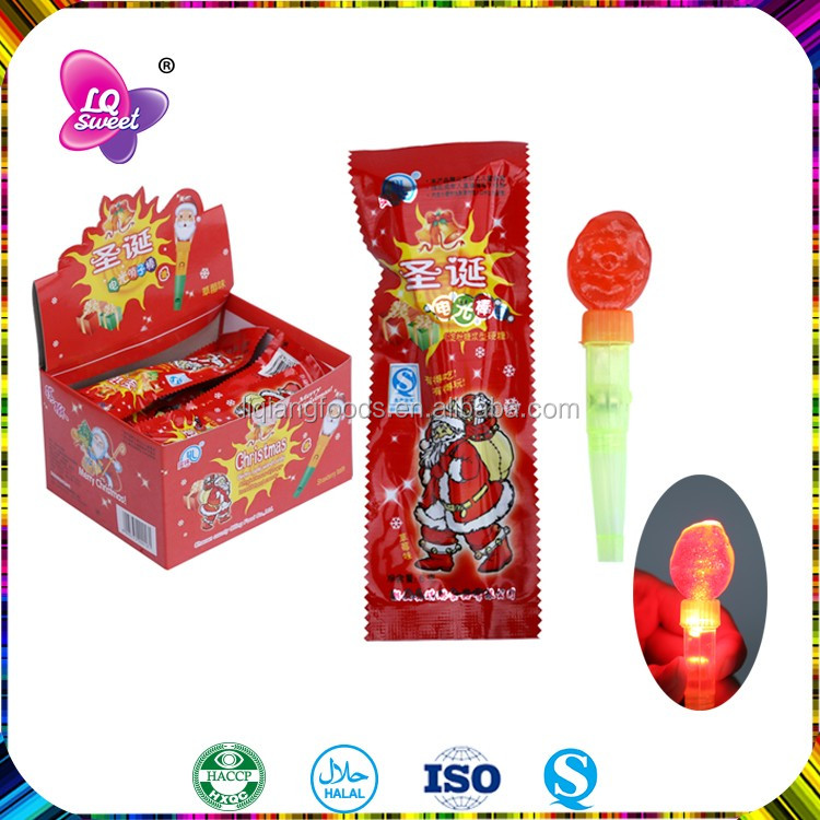 Box packing christmas candy with lollipop toy