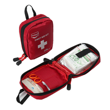First aid kit, a small emergency kit for sports and travel, band-aids, bandages and cotton swabs