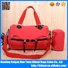 Fashion shoulder women red canvas travel bag with long handle