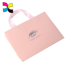 Beautiful Wholesale printing shopping paper bag with bow tie ribbon