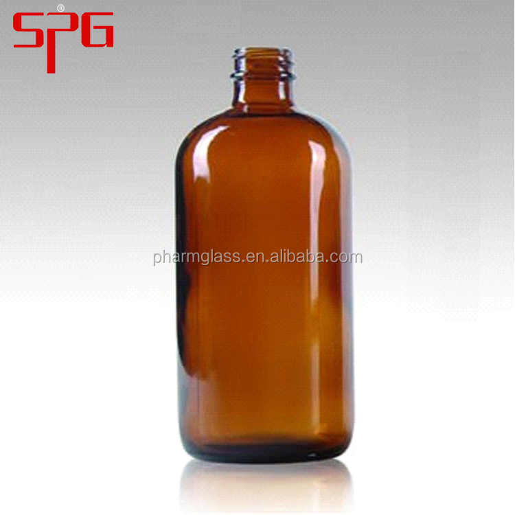 16 oz amber boston round glass bottle