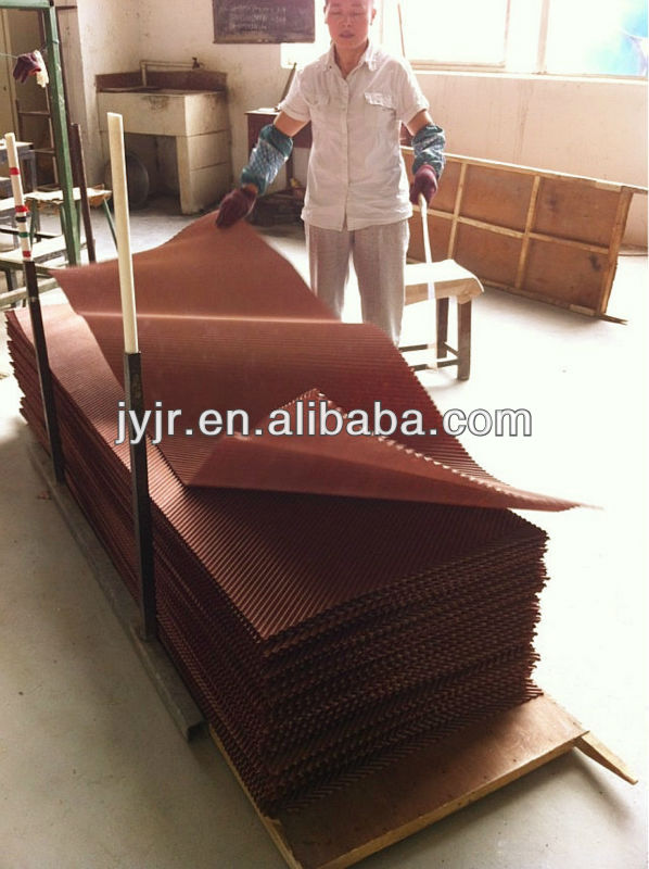 Water wet evaporator cooling pad