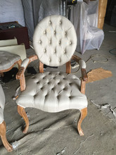 Buttoned tufted round back wedding chairs with arms