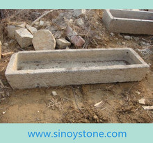 antique stone feed water trough for chickens