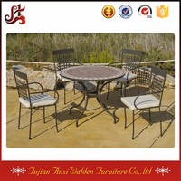 large round mosaic table and chairs outdoor