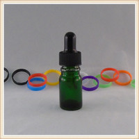 empty green small glass dropper liquid bottle for essential oil