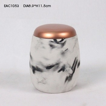 Gold sprayed lid concrete urn shape imitating marble canister