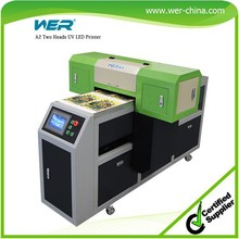 A2 420 * 1200 mm WER ED4212UV printing white and color same time 2 DX5 print head Digital Flatbed Printing Machine