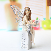 sweet angelic FAIRY and CHERUB with ENCLOSED LOOKING GLASS