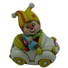 Resin clown figurine in car