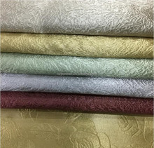 New Arrival 100% polyester one side shining one side dull new pattern emboss blackout fabric for curtain