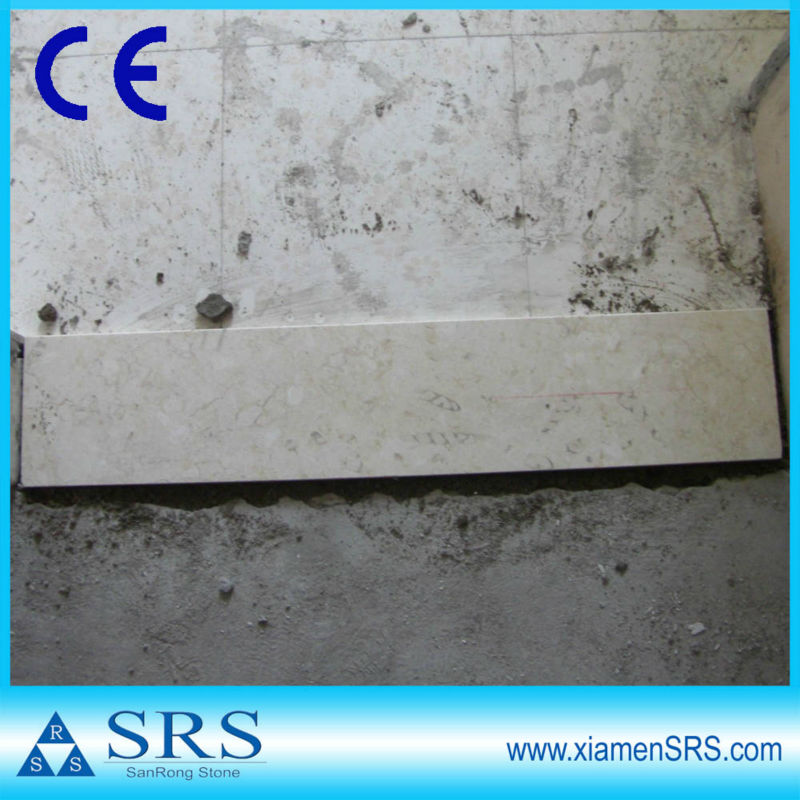 Beige marble door threshold