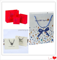 OEM high quality new design ribbon decorated gift bag accept custom