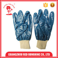 Blue nitrile dipped white cotton gloves for industrial work