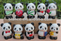 Miniature panda sculptures various designs