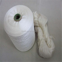 Raw white sewing polyester yarn on dyeing tube