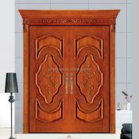 Villa main door with carving and natural wood veneer