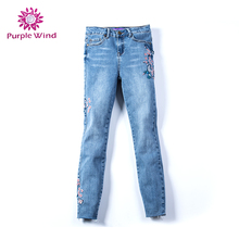 lady's jeans skinny high stretch stone wash with embroidery and raw edges