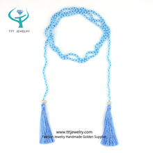 Long Blue Beaded Necklace with Crystal and Pearl Tassel Design