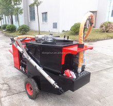 Road crack sealing machine with self heating tube
