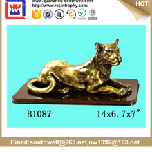 Decorative artificial resin leopard and tree stump