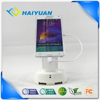 Cell phone store secure mobile phone display holder with alarm and charging