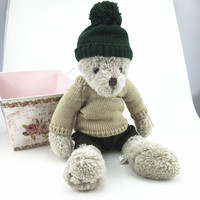 The Teddy Bear Wearing green knitted hat and brown knitted T-shirt