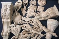 Architectural wood carvings like corbels, brackets, appliques and carved rosettes