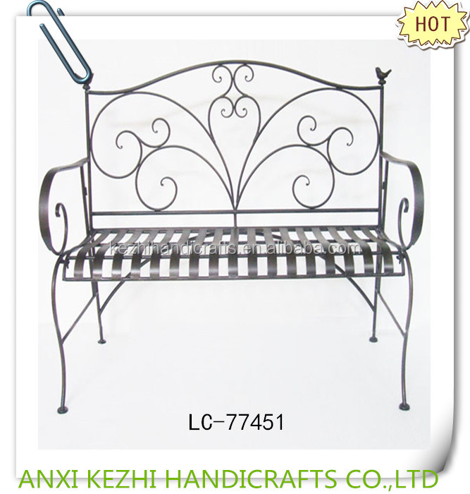 antique wrought iron garden bench with decorative birds
